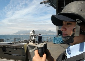 081007-N-2456S-011 CAPE TOWN, South Africa (Oct. 7, 2008) Aviation Ordnanceman 3rd Class Bianca Zamora stands the .50-caliber gun mount watch while the aircraft carrier USS Theodore Roosevelt (CVN 71) and crew depart Cape Town. Theodore Roosevelt and embarked Carrier Air Wing (CVW) 8 are underway on a scheduled deployment. (U.S. Navy photo by Mass Communication Specialist 3rd Class John Suits/Released)